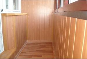 Отделка балкона МДФ панелями:правила установки, советы по выбору панели